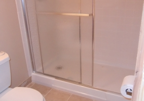 Modular shower unit added to a basement bathroom remodel