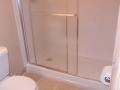 Modular shower unit added to a basement bathroom remodel