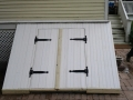 New exterior basement stair door and cover built on Victorian Home
