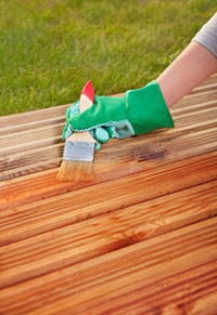 Applying protective varnish to deck.
